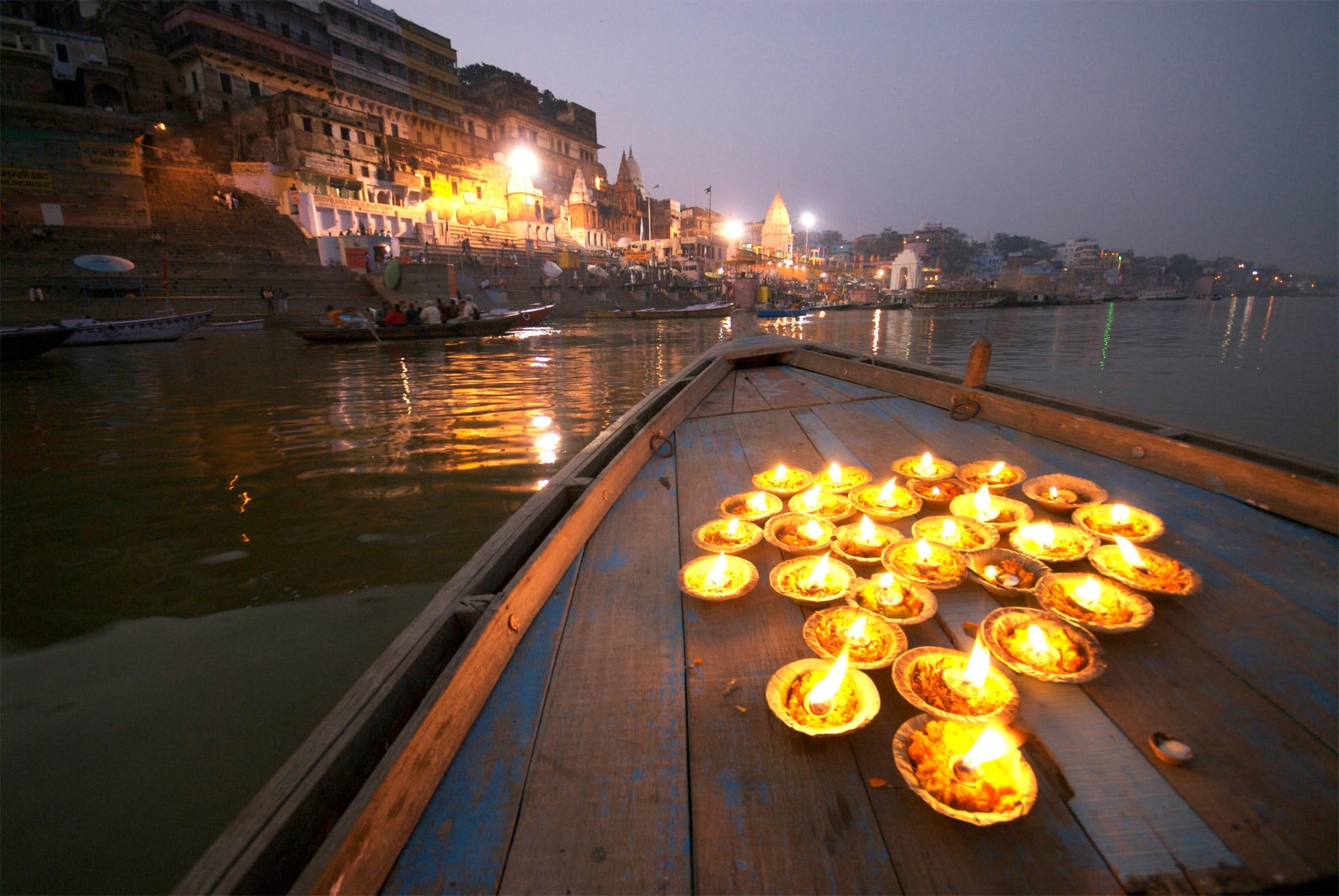 A candle boat on the river during Diwali