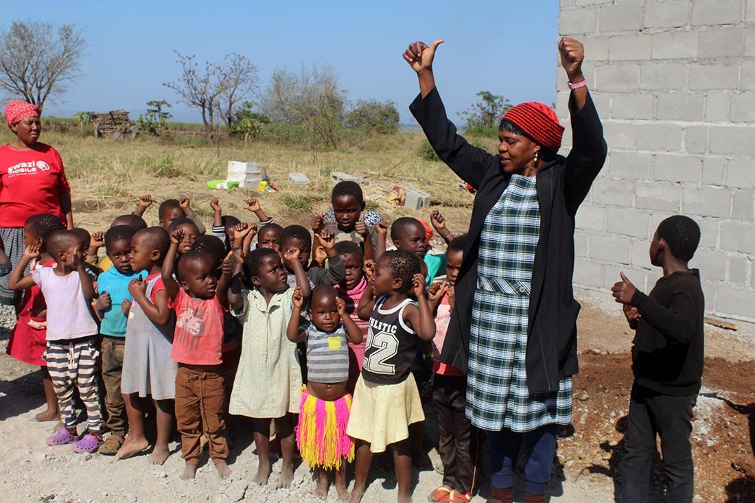 Teacher singing with orphan children